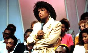 (OMG. Remember 80's Oprah?)